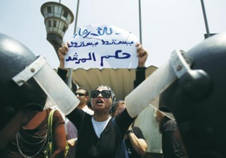 A woman shouts slogans against Egypt's President M