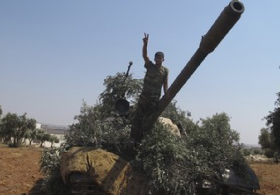 Syrian rebel with captured tank north of Aleppo