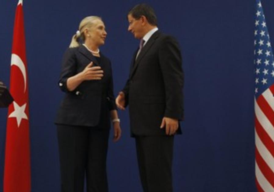 Clinton and Turkish Foreign Minister Davutoglu ta