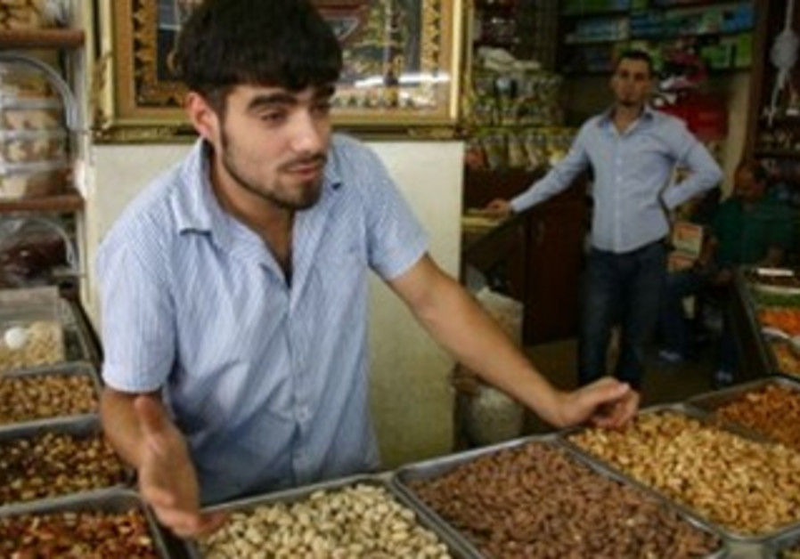 Ibrahim Muaqet stands over delicious-smelling nuts