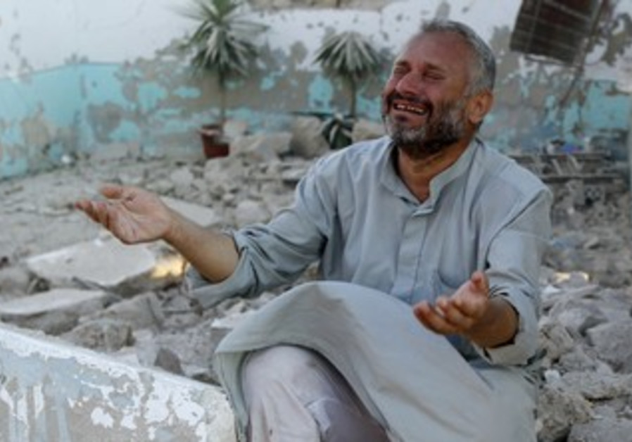 Man mourns after Syrian jets strike northern town