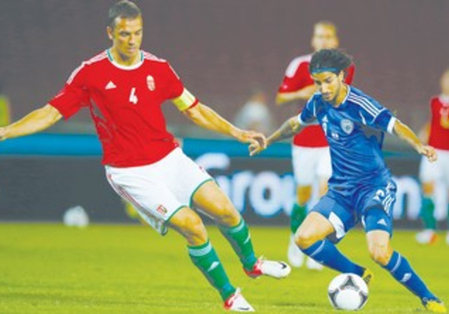 Lior Rafaelov battles with Hungary's Roland