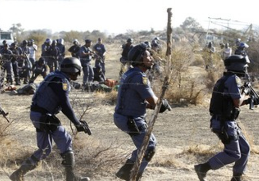 South African police clash with strikers