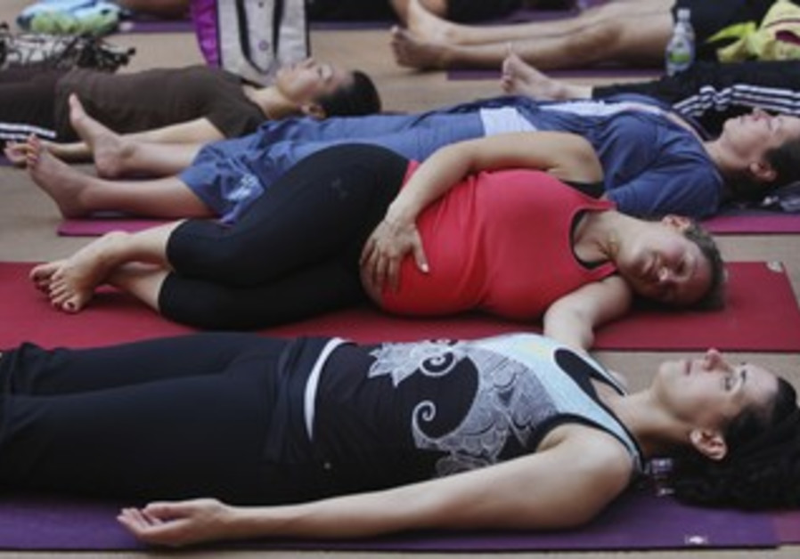 Pregnant woman does yoga in New York [file]