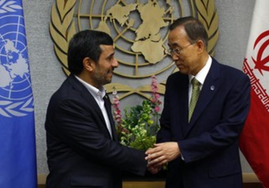 UN's Ban and Iran's Ahmadinejad shake hands [file]