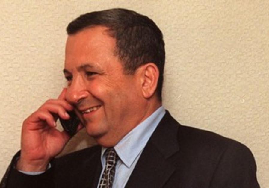 Ehud Barak talks on the phone