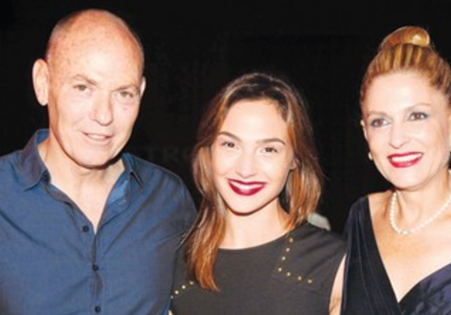 GAL GADOT (center) flanked by Gabi and Eti Roter