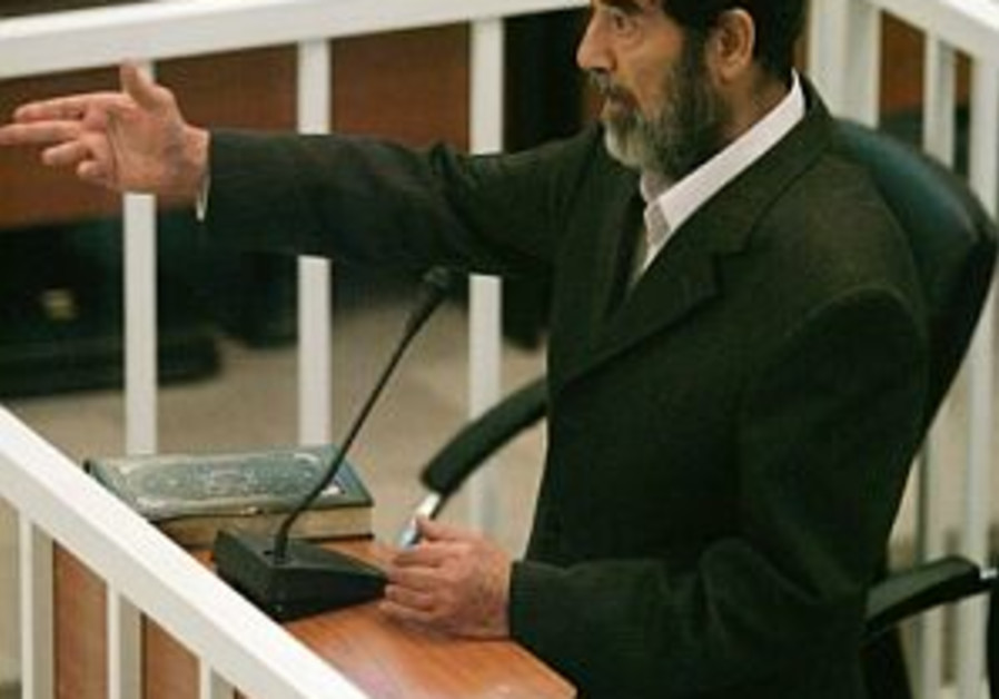 saddam hussein gestures while on trial 298