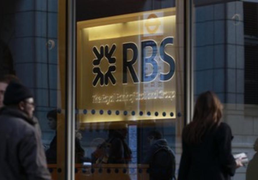People walk past a Royal Bank of Scotland (RBS)