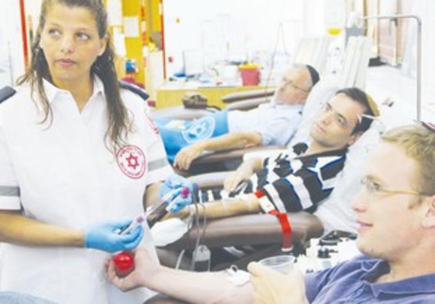 MOSHE GERLENTER, Israel and Ya'acov give blood