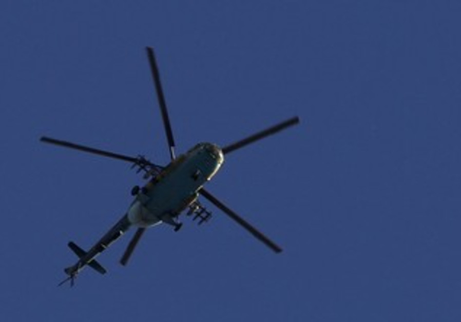 Syrian army helicopter prepares to fire missile