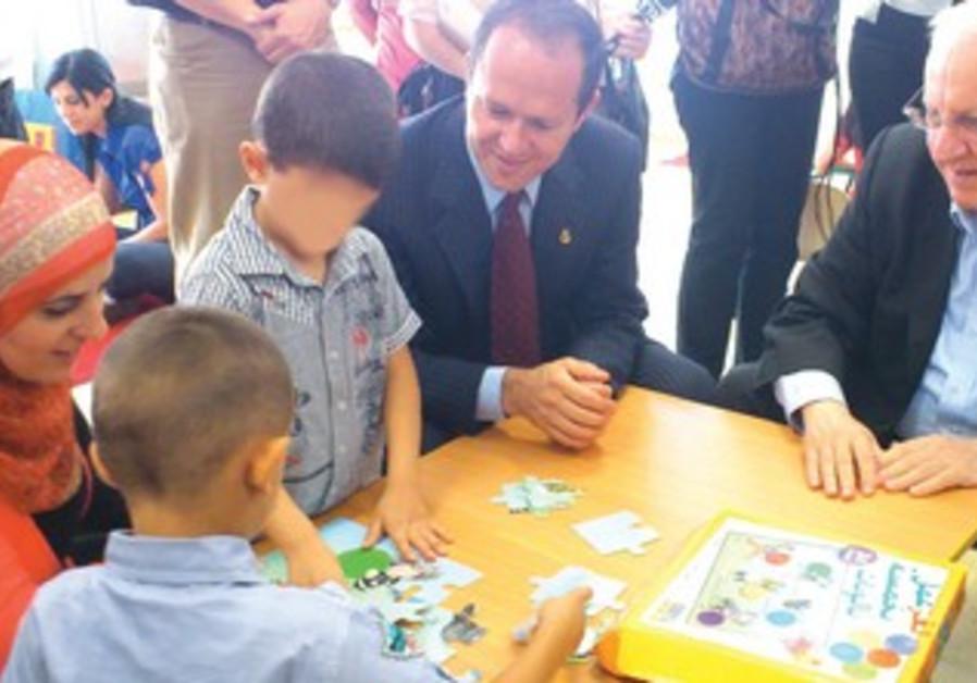 Barkat, Rivlin visit special needs Arab kindergart