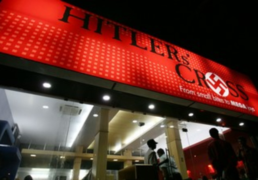 """Customers enter """"Hitler's Cross"""" restaurant"""