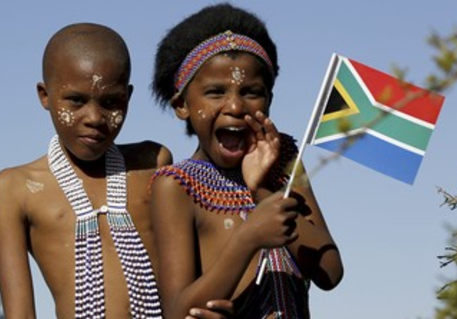 A child holds a South African national flag