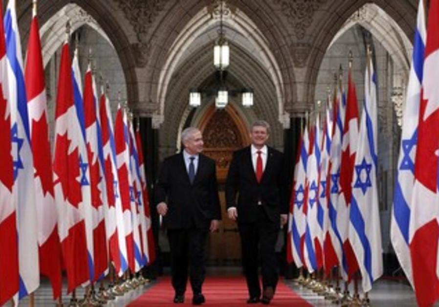 Netanyahu walks with Harper