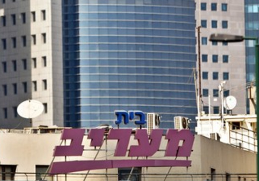 Maariv is seen on the newspaper's building in TA