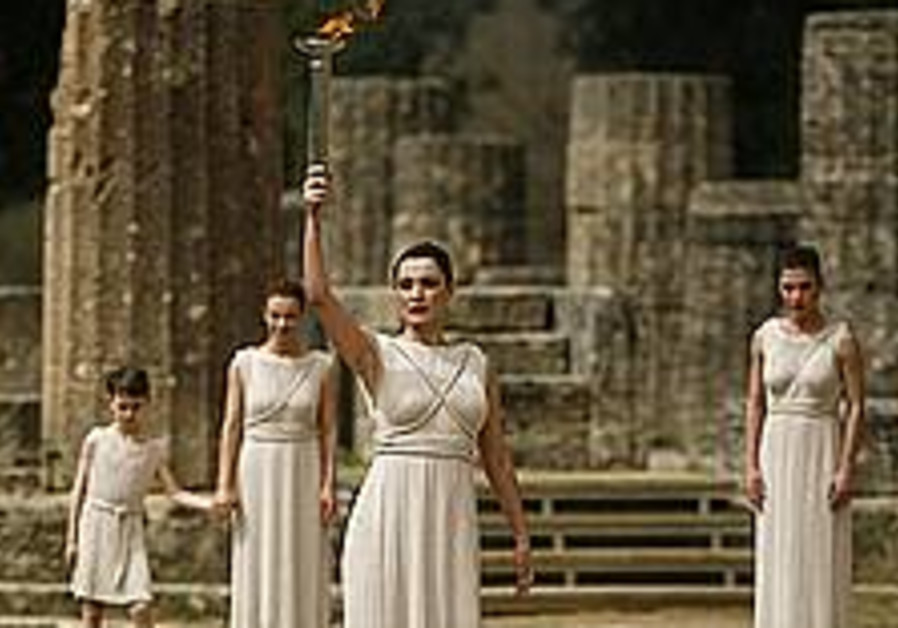 Olympic torch lit successfully despite weather conditions