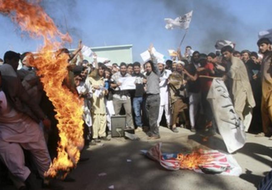 Protesters burn US flag in Afghanistan.