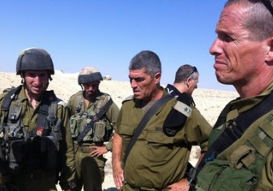 Tal Russo surveys scene of border incident