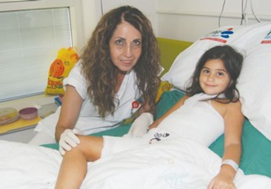 ORIENNE sits with nurse