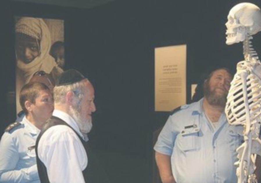 Religious Jews observe Bodies exhibit