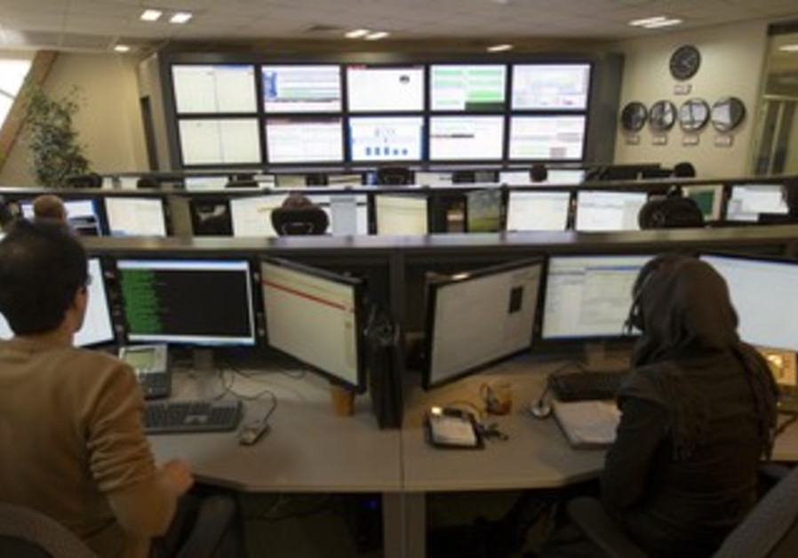 Iranians work on computer [illustrative]