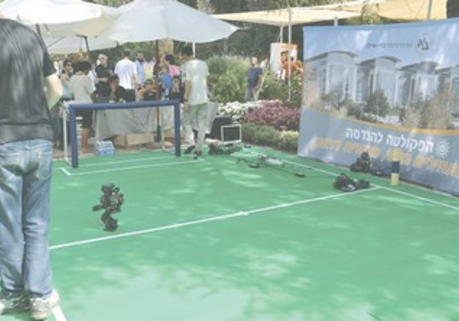 ROBOTS PLAY soccer at Peres's science open house