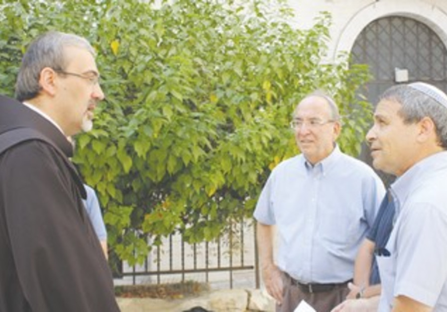 Ron Kronish (center) and Gadi Gvaryahu meet.