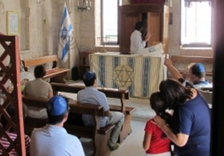 Ahead of Shabbat services in synagogue in Trani