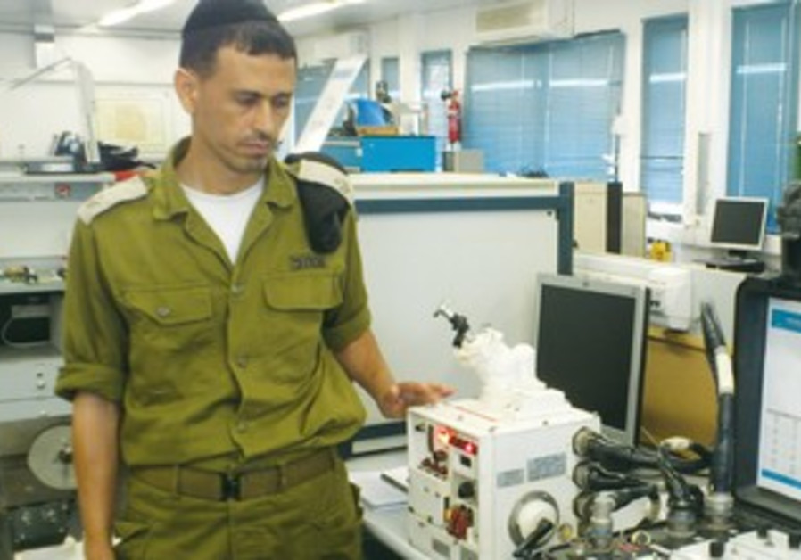 Staff Sargeant Major Aberlani with iRobot