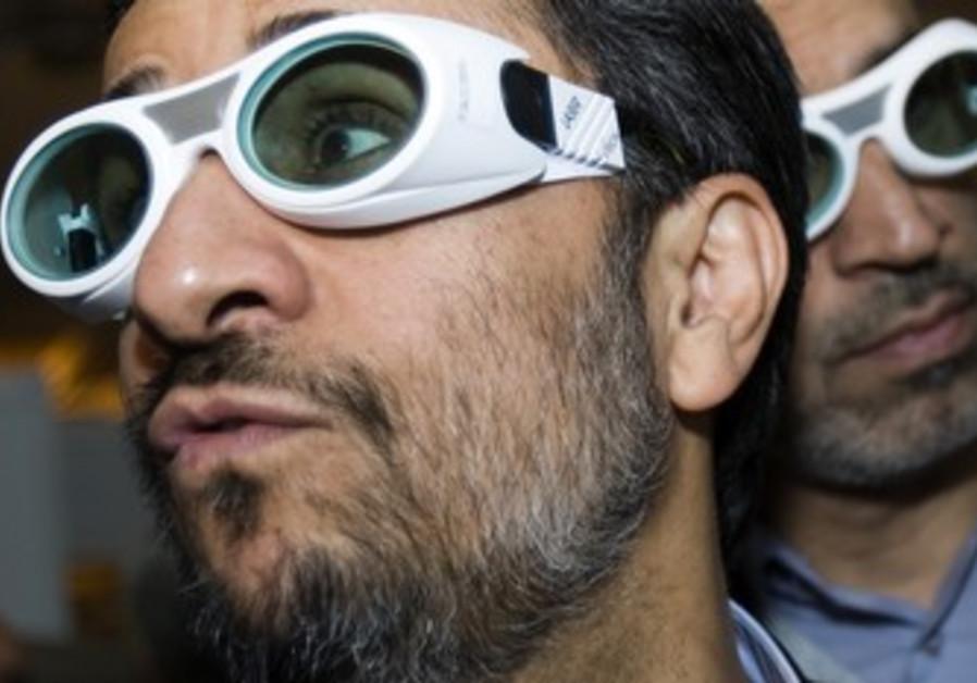 Iran's Ahmadinejad at Tehran laser conference.