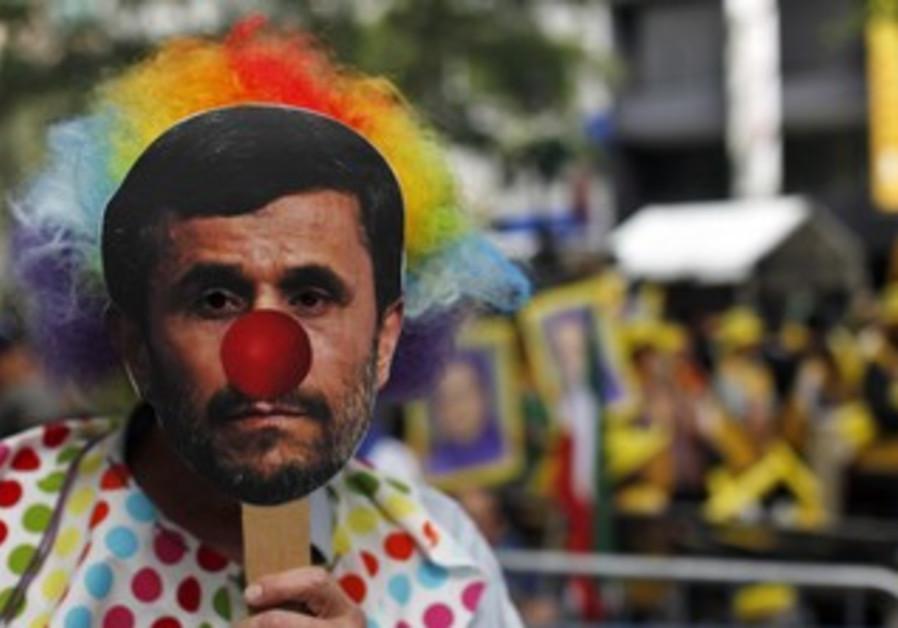 Protesters wear mask of Ahmadinejad [illustrative]