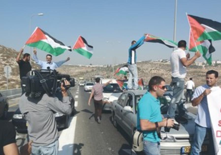 Palestinians, activists block Route 443