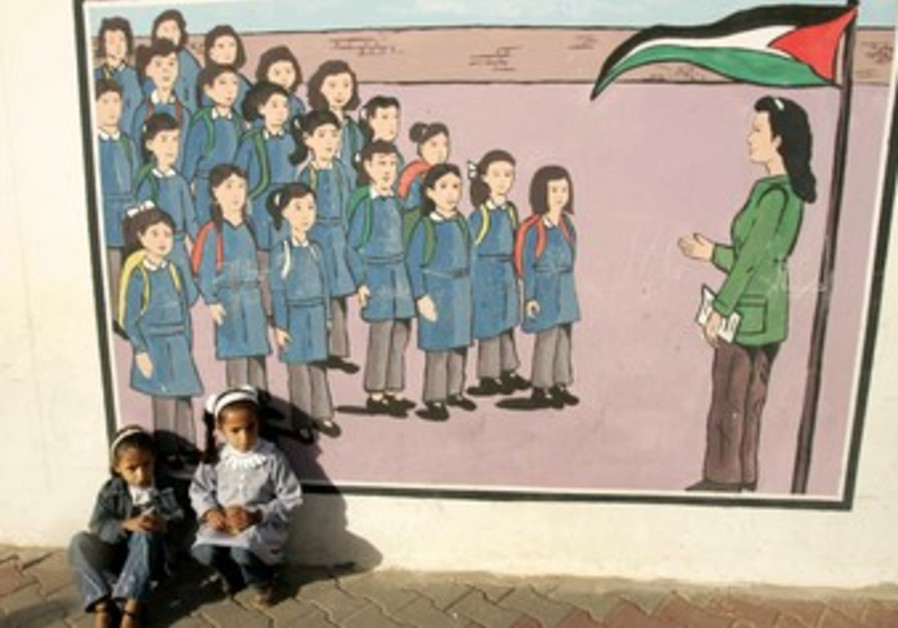 Palestinian kids sit at UNRWA school