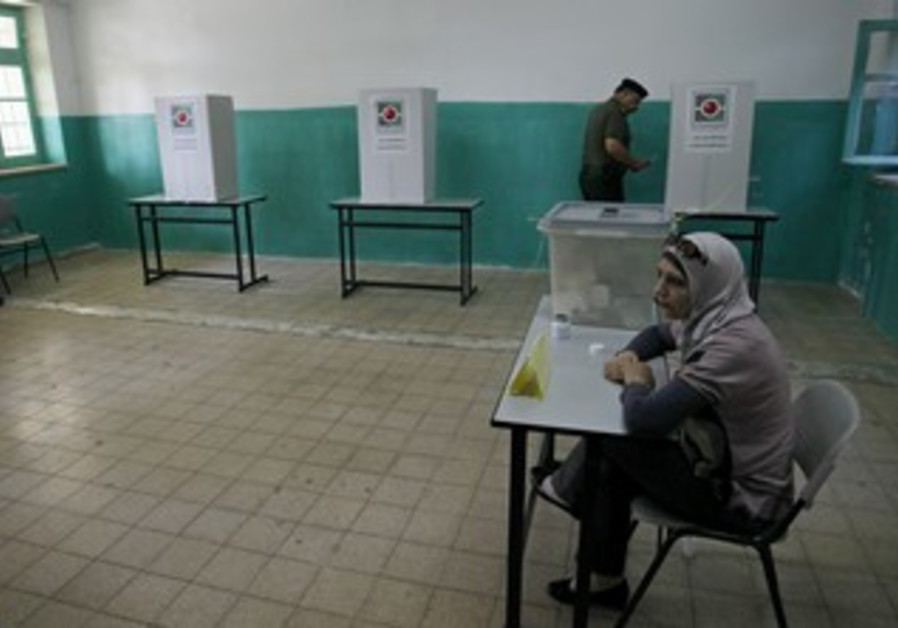 A Palestinian votes in local elections in Ramallah