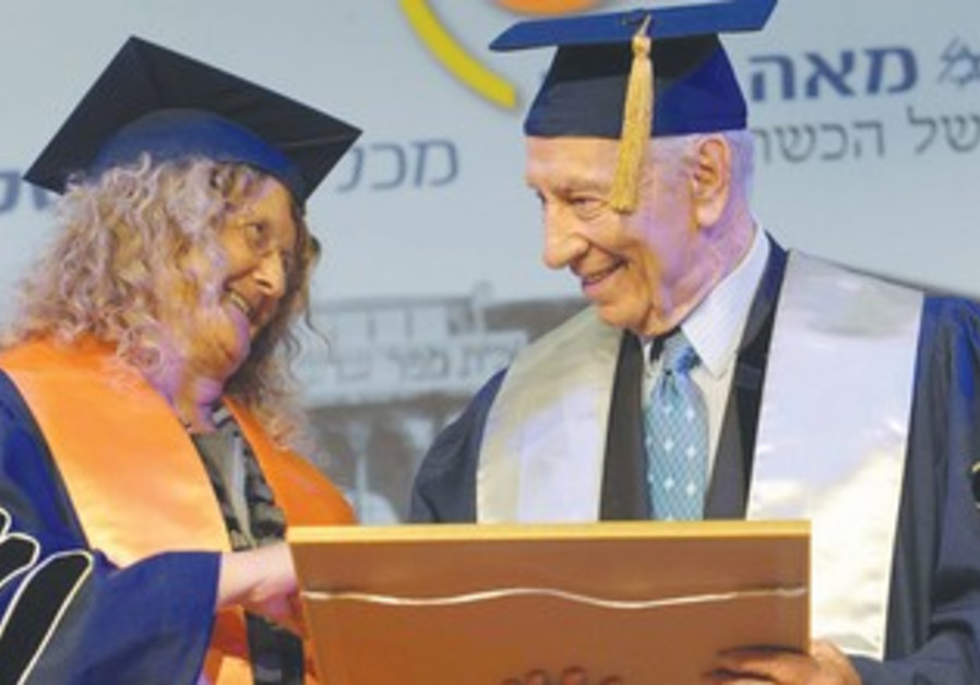 President Shimon Peres presents an honorary degree