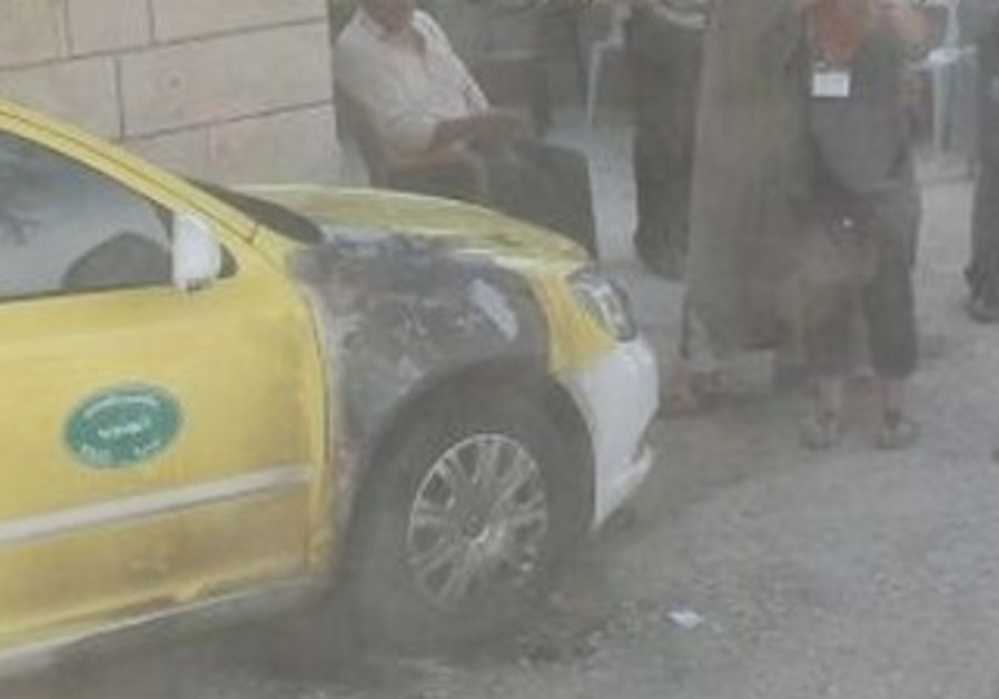 Taxi burned in suspected W. Bank price tag attack