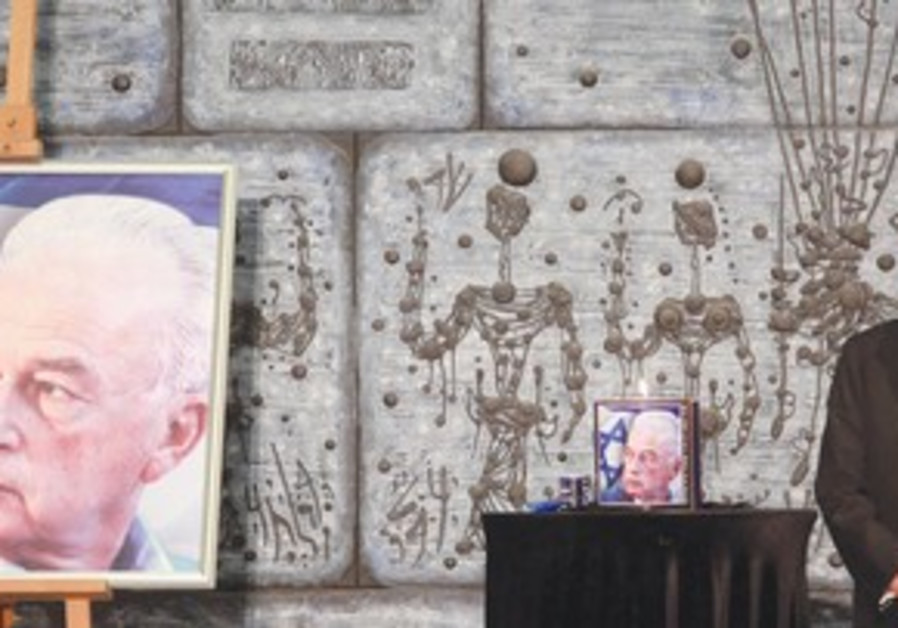 Peres stands by commemorative poster for Rabin
