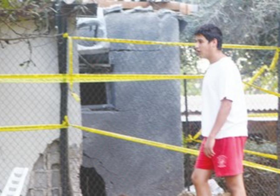 Resident surveys damaged house in Eshkol region