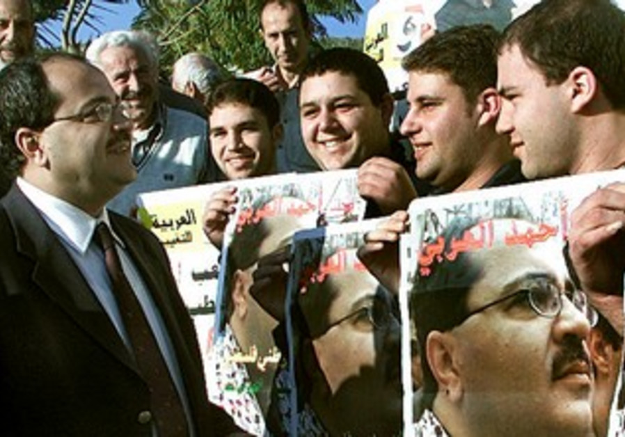 Hadash activists greet Ahmed Tibi
