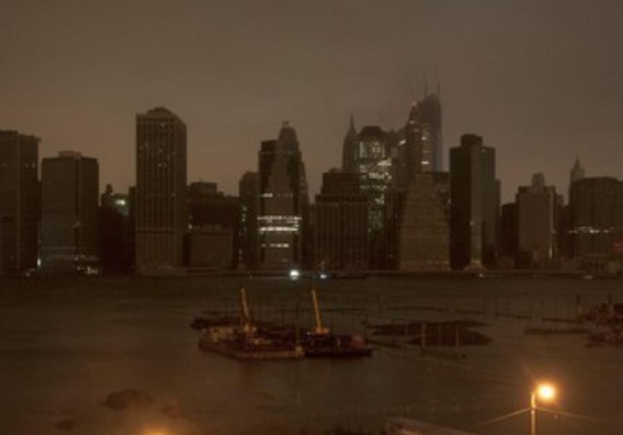 Dark Manhattan skyline in Hurricane Sandy.