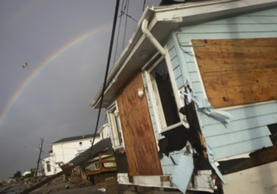A rainbow is seen among homes devasted by Sandy