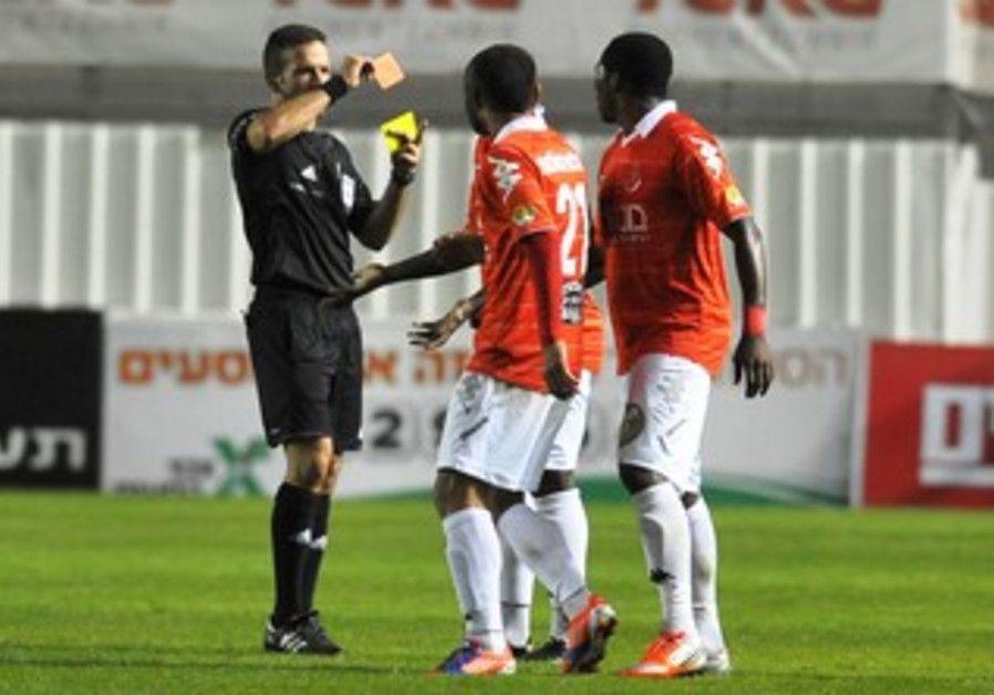 REFEREE OREL GREENFELD gives red card