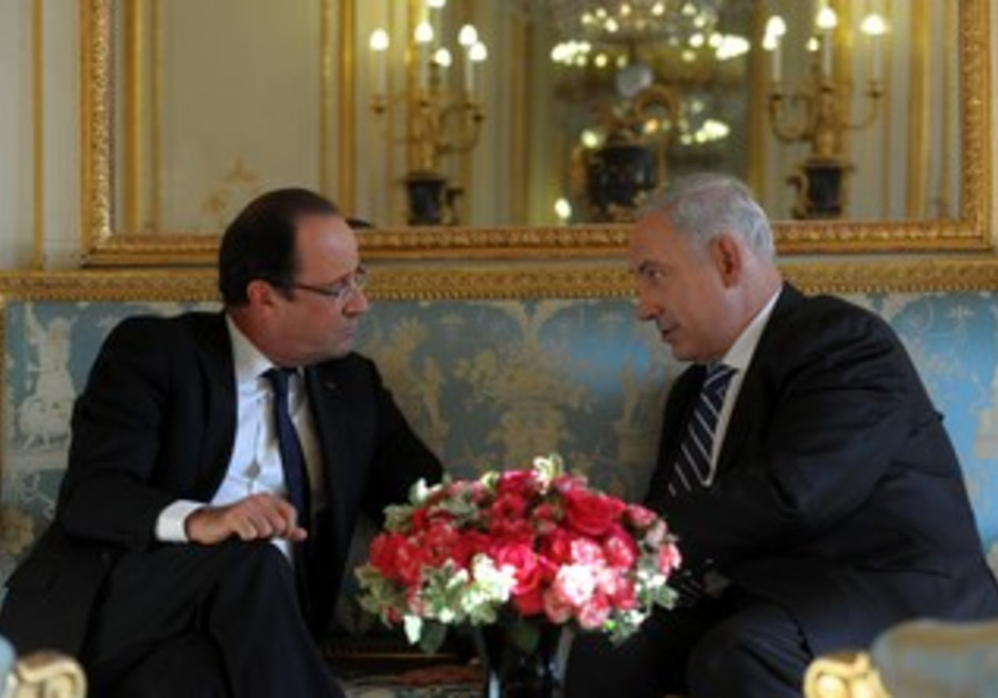 FRENCH PRESIDENT François Hollande and PM