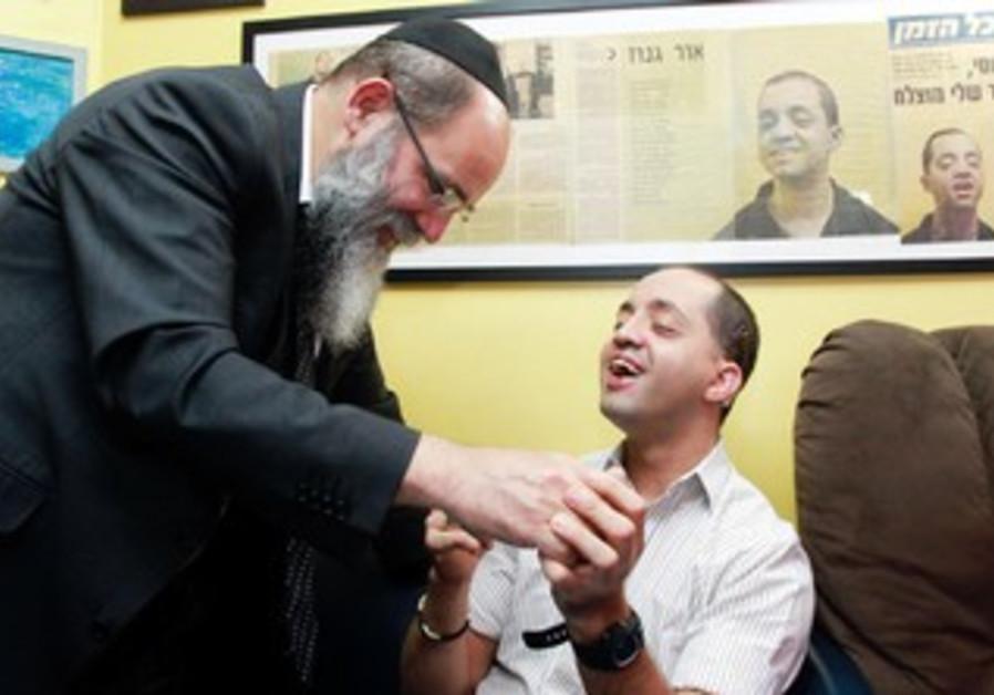 Rabbi Kalman Samuels and son Yossi