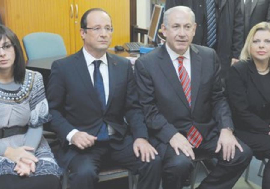 Sandler, who lost husband in attack, PM, Hollande