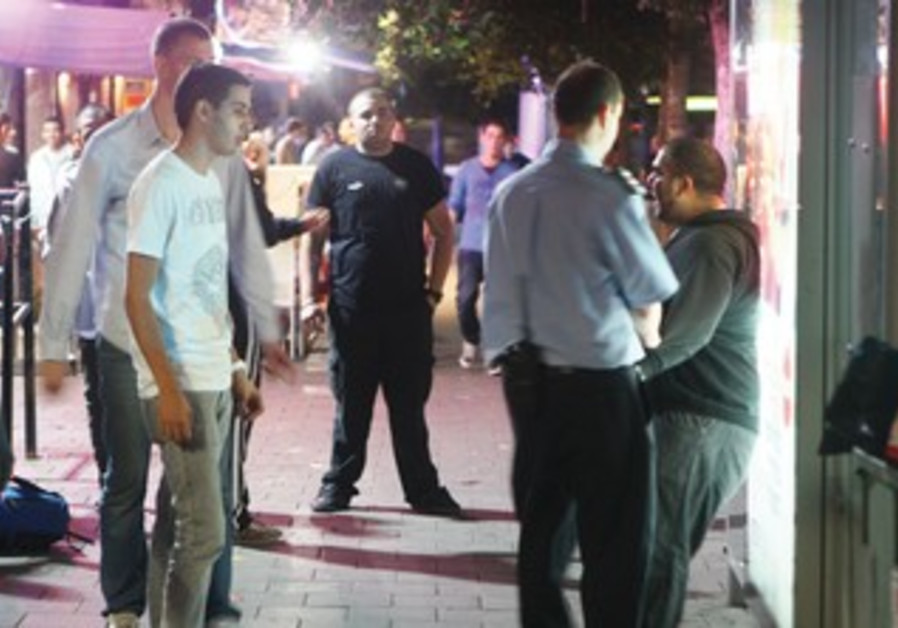 Police question youth outside club
