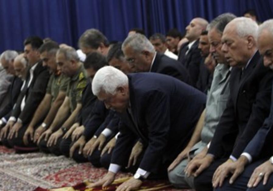 PA President Mahmoud Abbas praying