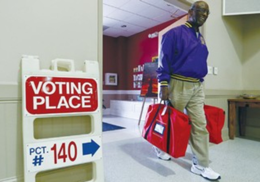 Bill Partlow carries voting supplies in Pineville