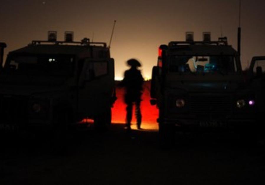 IDF soldier on patrol along Gaza Strip.